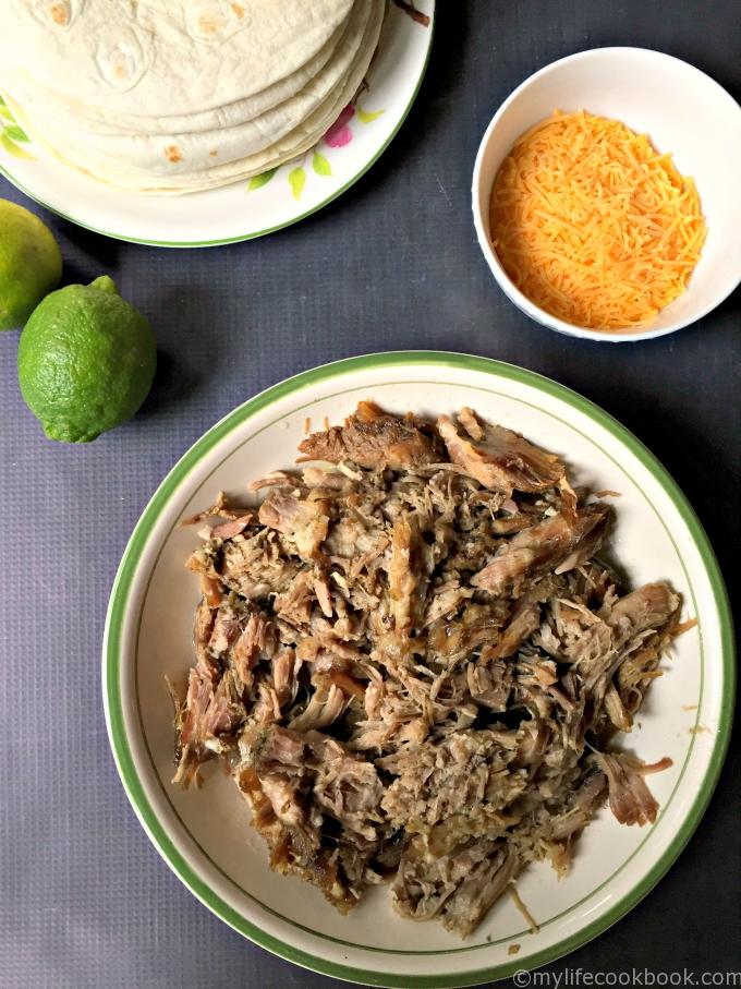 Slow cooker zesty garlic pulled pork is made with zesty limes and lots of garlic and is a delicious low carb and Paleo dish. Great  for tacos or sandwiches or can even be served as is.
