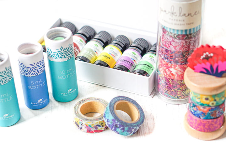 box of Plant Therapy essential oils and tube of Park Lane washi tape