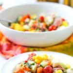 white bowl and plate with pickled vegetable antipasto salad with text