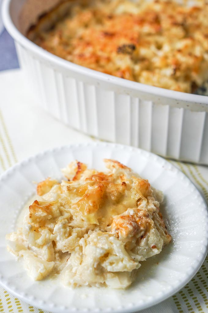 Enjoy all the comforts of a cheesy scalloped potato dish using cauliflower instead! This low carb scalloped cheesy cauliflower is only 4.5g net carbs and super easy to make.