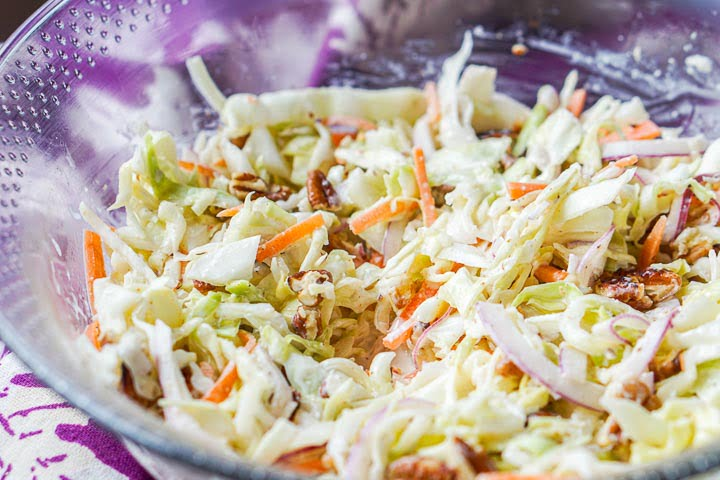 closeup of the bowl of keto coleslaw with pecans