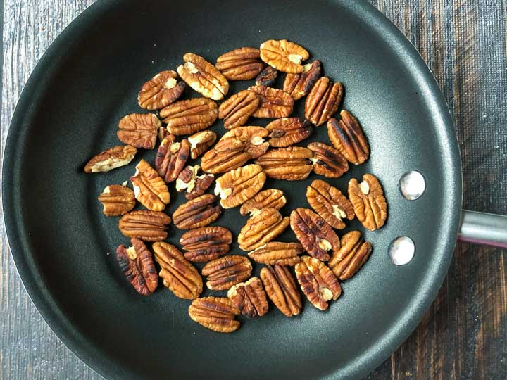 pan with whole roasted pecans