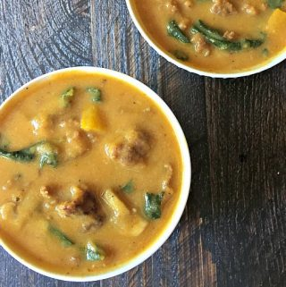 This delicious creamy pumpkin soup gets it's creaminess from a cauliflower puree and pumpkin. The sausage and kale make it a flavorA delicious healthy low carb comforting soup.