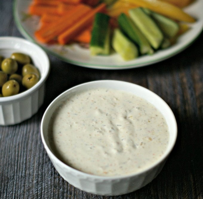 My mom's green olive & garlic veggie dip is a welcome change from your everyday ranch vegetable dip. Garlic, green olives and spices give it a special taste and it's low carb with only 0.6 net carbs per serving.