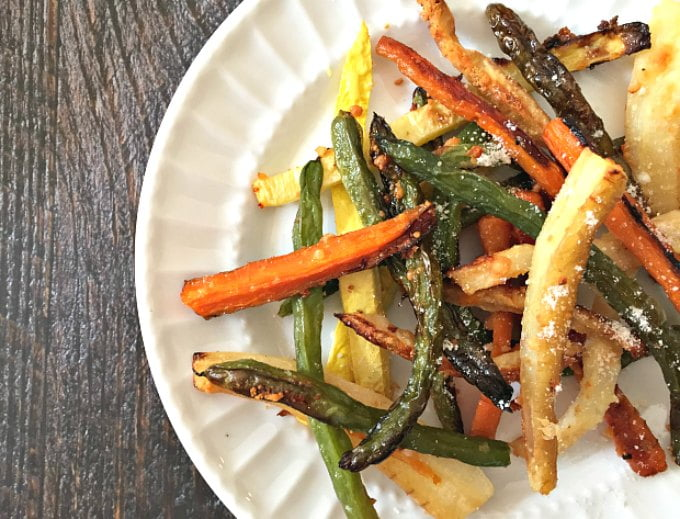 These Parmesan garlic veggie fries are a tasty side dish or snack and a healthy change from potatoes. Oven roasted and topped with salty cheese make these a delicious and healthy dish!