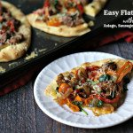 This flatbread is so easy and delicious with toppings of sausage, peppers, spinach and Asiago cheese. Make a delicious dinner for your family in minutes.