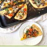 cookie sheet with asiago sausage & peppers easy flatbread with text overlay