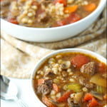 white bowl with Instant Pot Beef Barley soup with text overlay