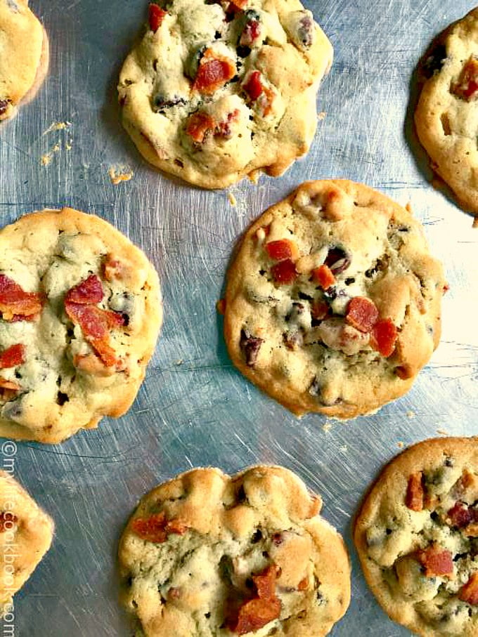closeup of baked ultimate chocolate chip cookies with bacon on top