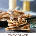 pieces of chocolate peanut butter pretzel toffee with ribbon in background and text