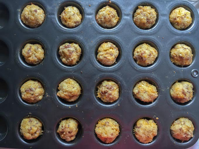 muffin tin with baked sausage muffins