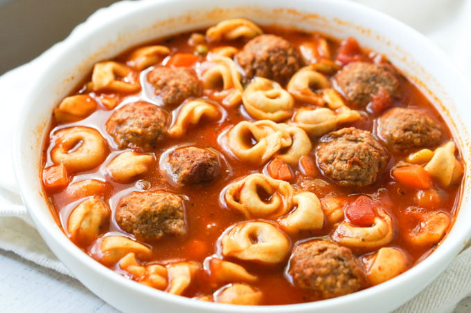 large white bowl with Italian meatball & tortellini soup