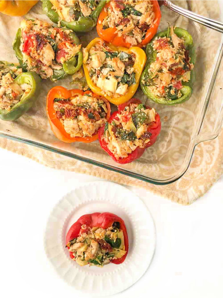 baking dish and white plate with chicken stuffed bell peppers