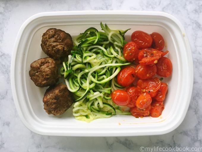 Paleo meatballs go great with roasted grape tomatoes and zucchini noodles to make a healthy freezable lunch. Save time and stay on track with this simple and easy meal.