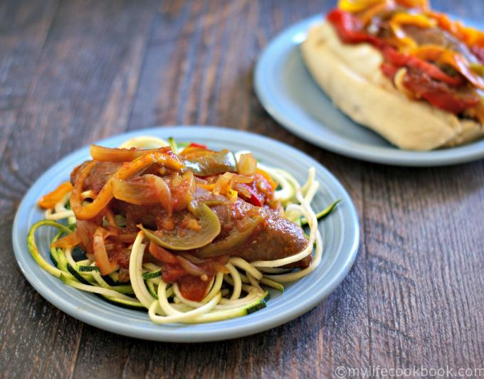 Slow cooker Italian sausage and peppers is aSlow cooker Italian sausage and peppers is an easy and versatile dish. Eat it on a bun or over pasta. Or for lower carbs eat as is or over zucchini noodles.n easy and versatile dish. Eat it on a bun or over pasta. Or for a lower carbs eat as is or over zucchini noodles.