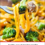 A forkful of sausage and butternut noodles with text