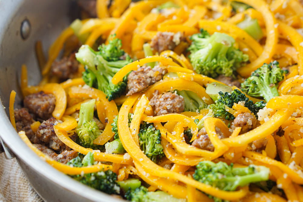 closeup of pan of sausage and spiralized butternut squash with broccoli