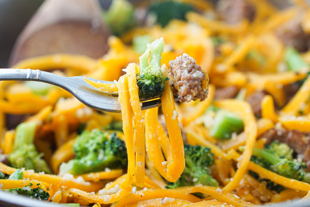 closeup of a  forkful of sausage and butternut noodles