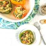 low carb Greek chicken stuffed peppers in baking dish with text overlay