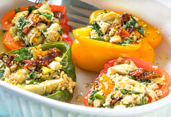 These Greek chicken stuffed peppers are an easy yet delicious meal that is low carb and Paleo too. A healthy meal under 30 minutes and with only 3.9g net carbs per pepper!