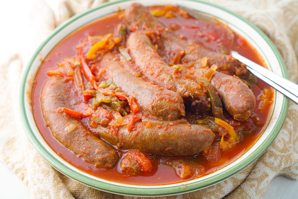 close-up of a bowl of slow cooked Italian sausage and peppers