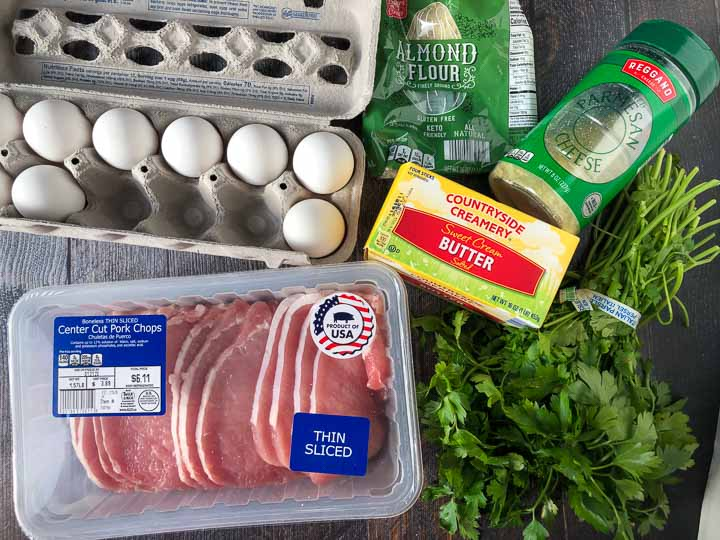Aldi ingredients for low carb pork chops - eggs, almond flour, thin cut pork chops, butter, parsley and parmesan cheese