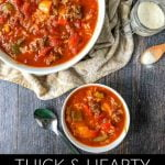 white bowls of easy & spicy stuffed pepper soup with text