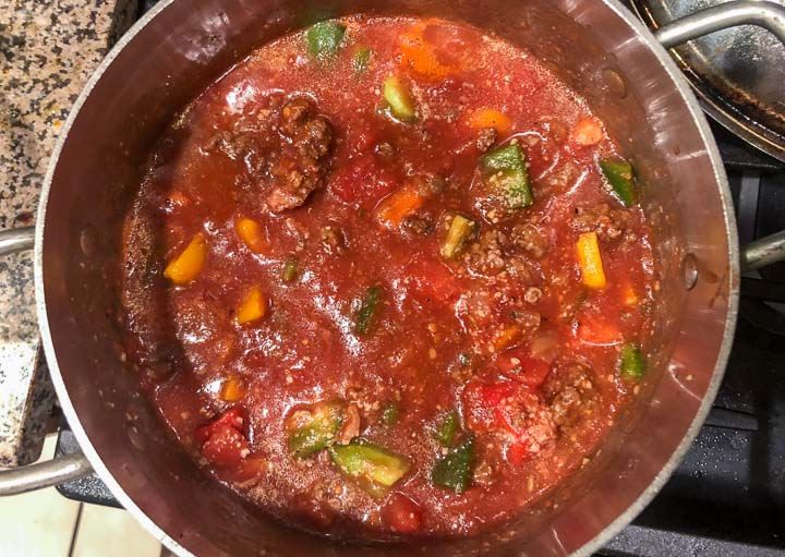 a soup pot of the spicy stuffed pepper soup before cooking down