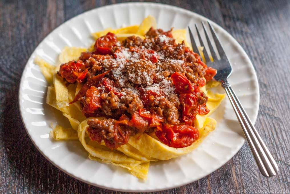 These low carb sausage and egg noodles are both fun and tasty. A delicious tomato and sausage sauce covers the noodles that are literally made from eggs.