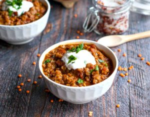 This spicy Mexican red lentils dish is a hearty, healthy meal. Spicy and comforting, this is the perfect vegetarian chili alternative.