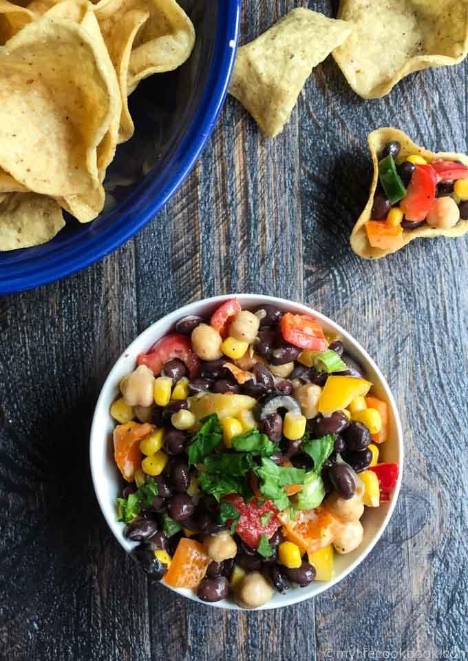 This easy veggie and bean dip is a colorful and tasty dish to make for your next party. Eat with tortilla chips or as a salad.
