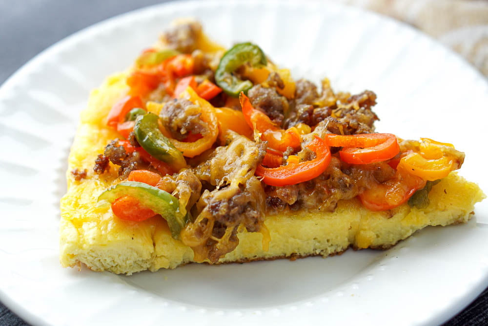 closeup of a piece of breakfast frittata with sausage and peppers