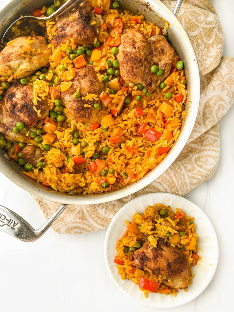 aerial view of a pan and white dish with colorful chicken and rice dish