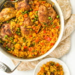 white plate and silver pan of Spanish chicken and rice with text overlay
