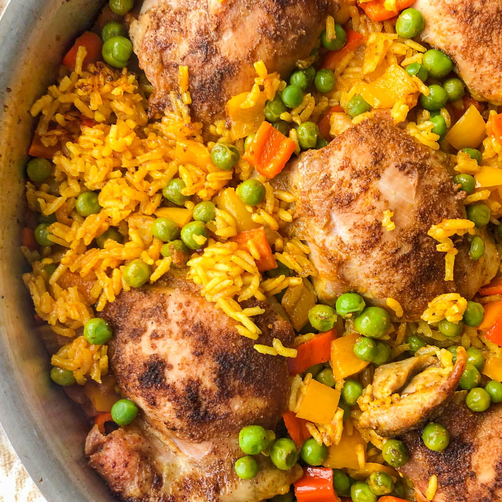 closeup of a pan of Spanish chicken and rice