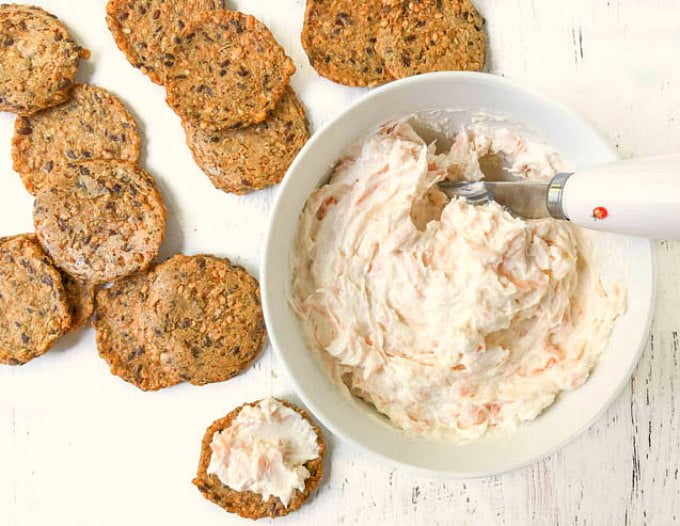 white bowl with low carb smoked salmon cream cheese dip, celery, crackers
