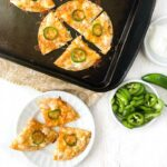 cookie sheet with seafood nacho with text