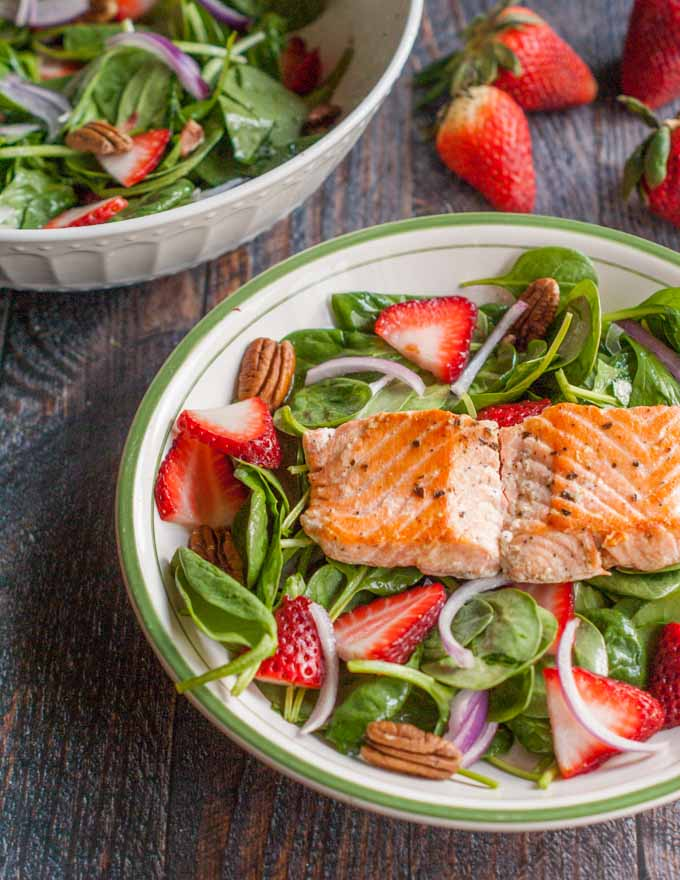 A fresh and delicious strawberry salmon salad with the sweet kick of ginger dressing. Easy to make for a healthy lunch or dinner.