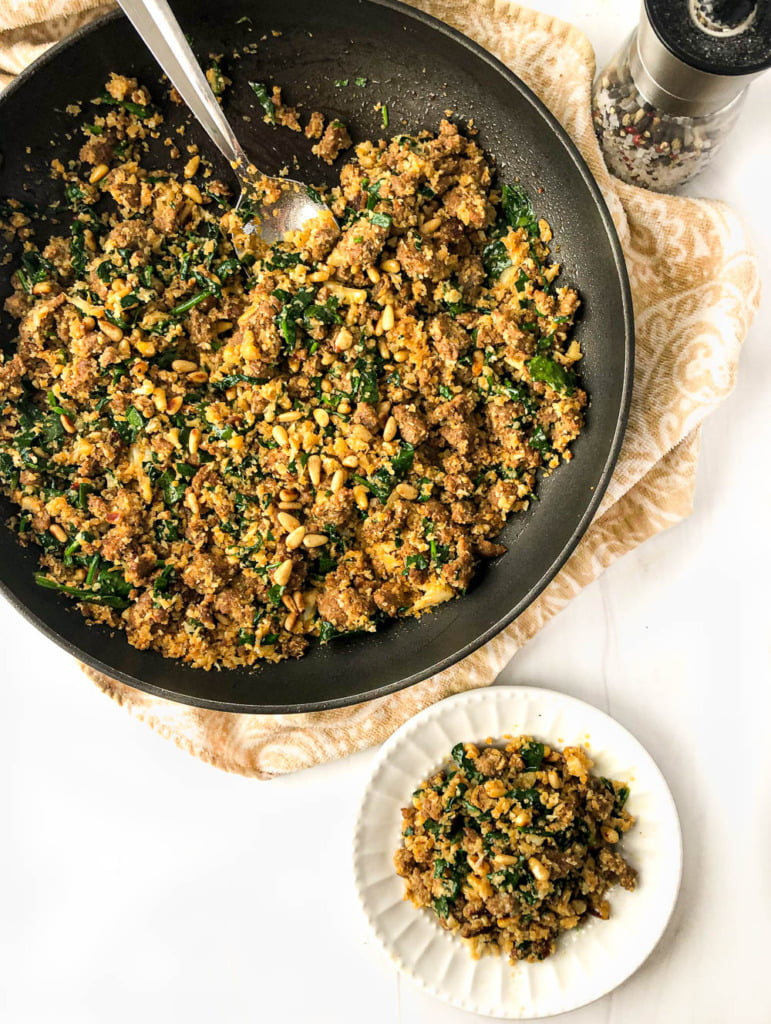 aerial view of pan and white plate with cauliflower rice hash with spinach
