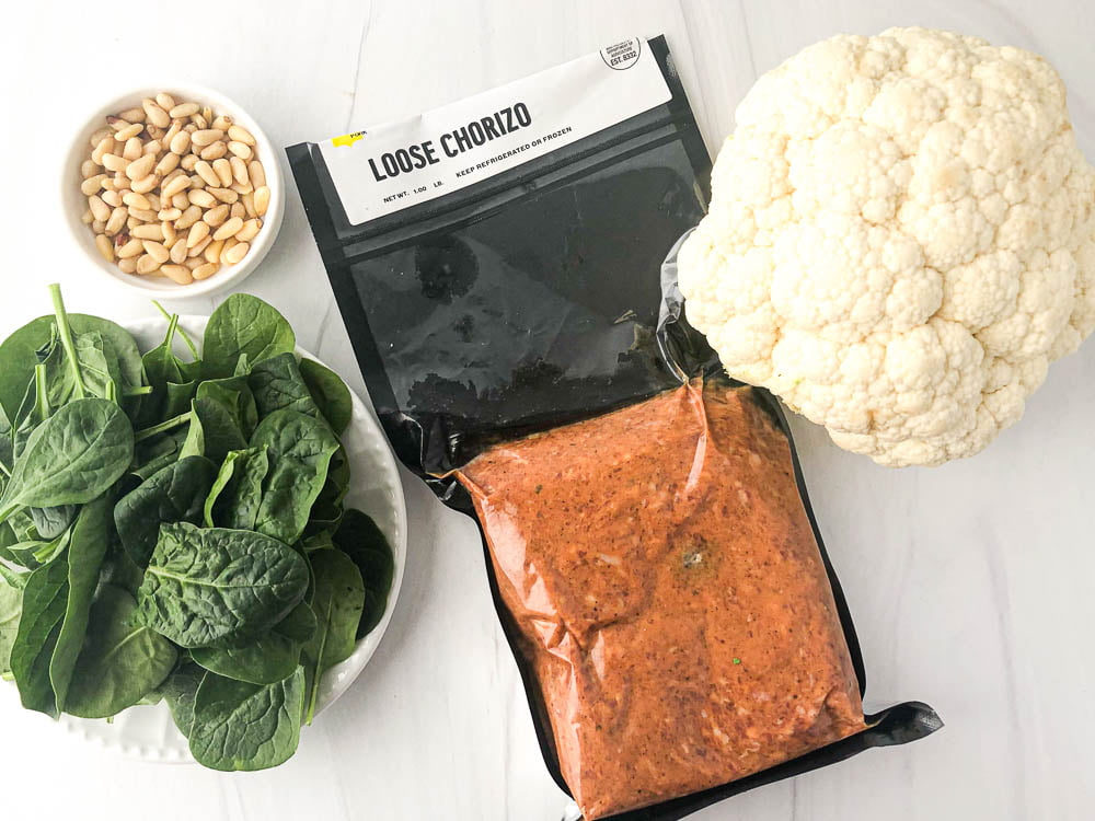 ingredients in this recipe: head of cauliflower, pine nuts, baby fresh spinach, chorizo