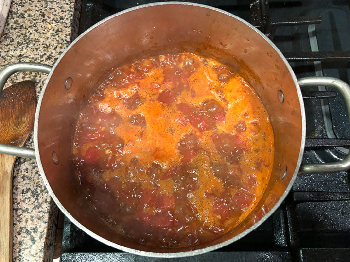 pot with the red lentil chili starting to simmer on the stove