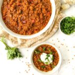 white bowls with spicy Mexican red lentils with text