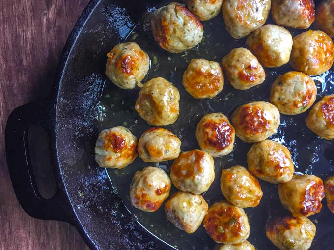 These spicy apricot chicken meatballs have the perfect balance of sweet and heat. They are easy to make and perfect for your next party. #SundaySupper
