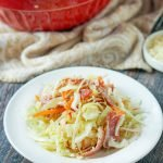 red bowl and white plate with antipasto keto cabbage salad with text