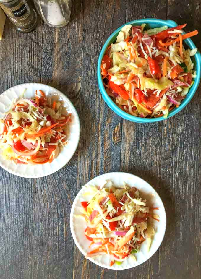 This antipasto coleslaw is a nice change from your standard creamy coleslaw. A great low carb salad to take to a picnic!