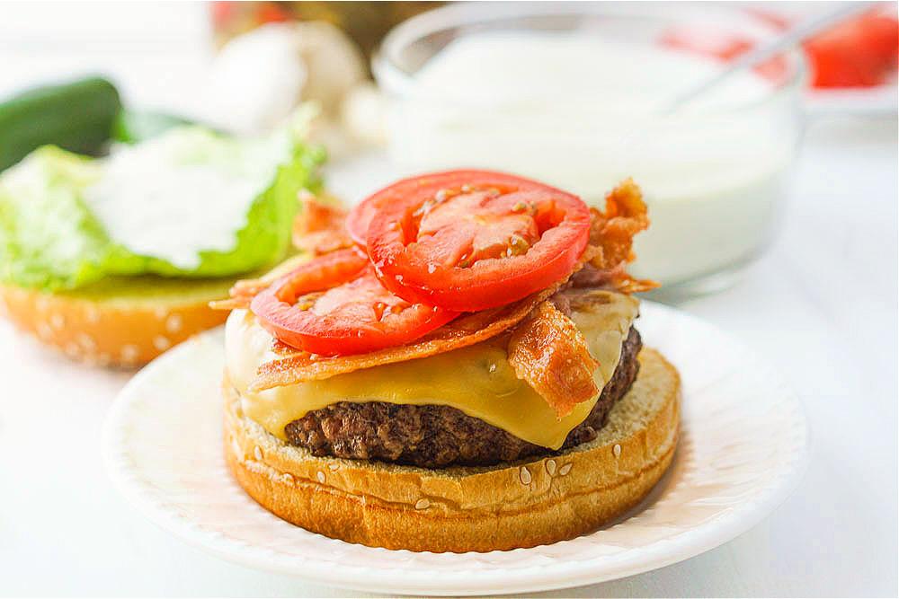 hamburger with bacon and fresh tomato