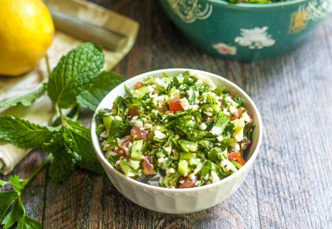 This cauliflower tabouli is a great gluten free alternative to traditional tabouli. Light and refreshing, it's a delicious summer salad.