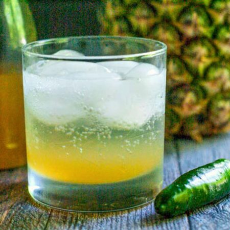 This pineapple jalapeño shrub cocktail has the sweetness of pineapple, the tang of vinegar and the heat of jalapeños. Great with seltzer or vodka for a refreshing summer drink.