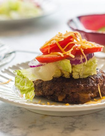 This cheddar stuffed taco burger is a delicious change from your everyday burger. Customize with all your favorite taco toppings. #SundaySupper
