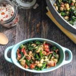These easy bacon beans & greens are the perfect way to use greens from your garden. Serve as a hearty side dish or as a main course. #SundaySupper